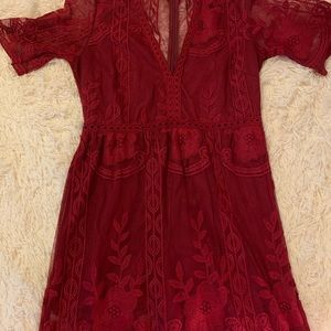 Red lace romper with sheer floor length skirt